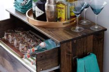 02 a dark stained IKEA Tarva dresser with a pullout drawer for stashing glasses and bottles is a chic rustic bar idea
