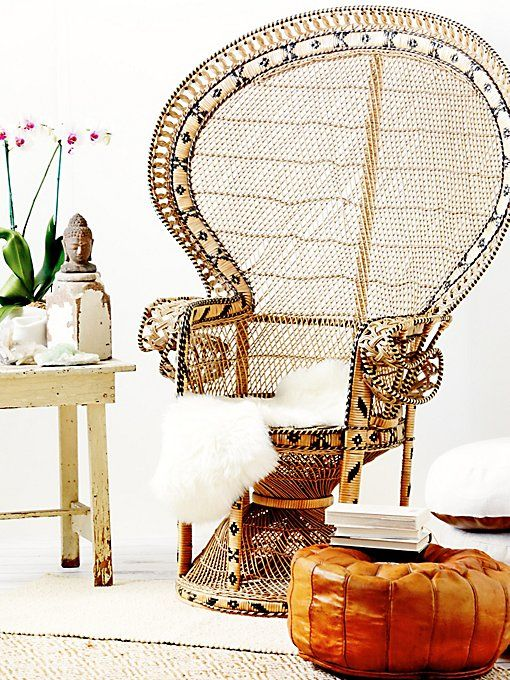 a peacock chair with yarn wrapping that adds a print to it, an amber leather ottoman and faux fur is impressive