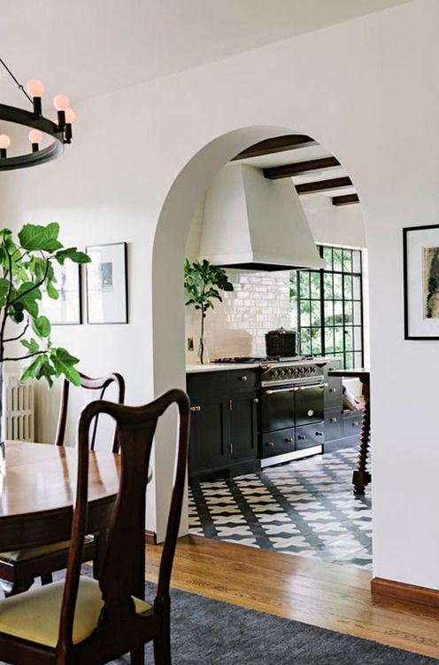 an arched doorway leading to the kitchen hints on vintage style and touches of Spanish colonial decor you'll see