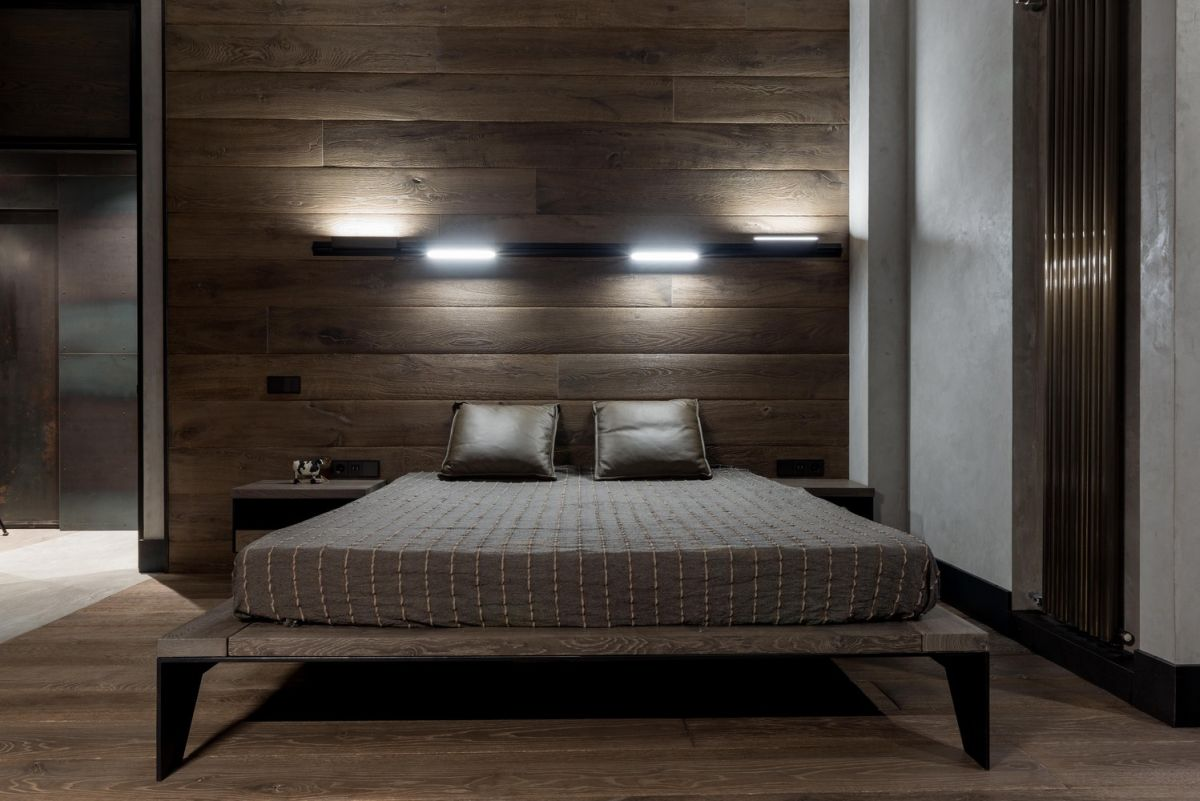 a cozy bedroom with a wooden accent wall