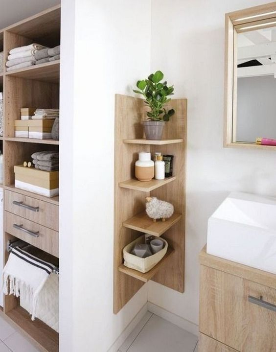 a comfortable wooden shelving unit with a base is ideal for a contemporary bathroom