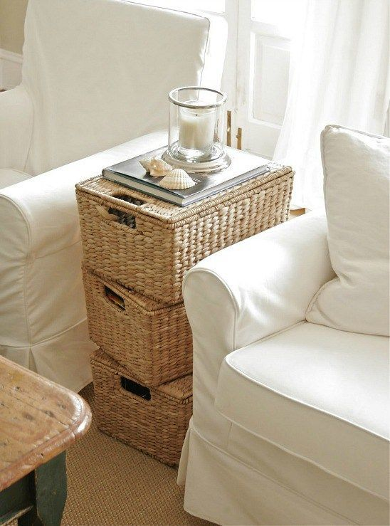 a stack of wicker baskets will work as a coffee table and as storage units, and it will match many spaces
