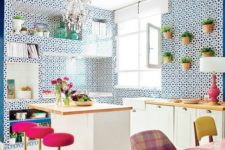 03 super bright pink stools with gold bases stand out in the blue and white kitchen and add a glam feel to the space