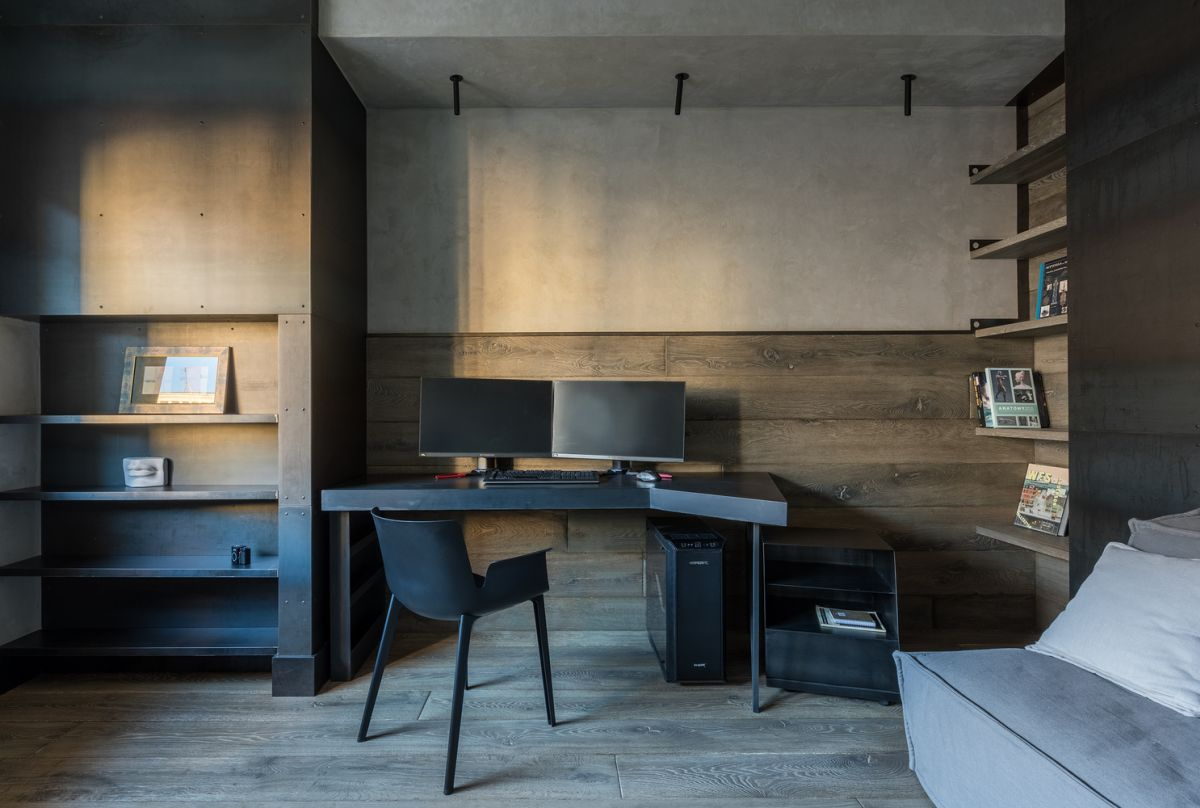 The wooden touches contrast the laconic metal surfaces and add coziness to the space