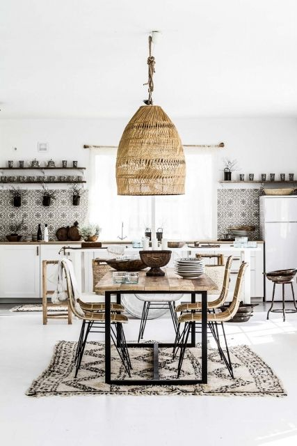 a boho eclectic kitchen and dining space with an oversized wicker lampshade over the dining zone and mosaic tiles