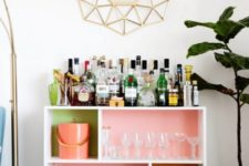 04 a bright home bar made of an IKEA Valje shelf with colored contact paper to spruce up the inside of each compartment