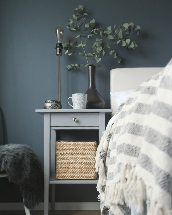 an IKEA Hemnes bedside table hack in elegant grey and with a single metallic knob is a stylish idea