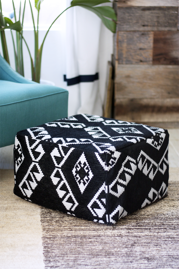 an IKEA footstool turned into a comfy boho folksy pouf in black and white with catchy patterns