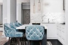 04 soft baby blue tufted stools on dark stained legs add color to the space and look very inviting and chic