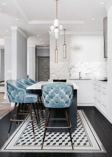 soft baby blue tufted stools on dark stained legs add color to the space and look very inviting and chic