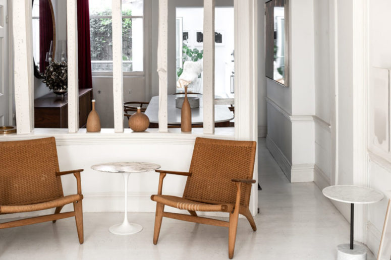 The home if decorated with understated elegance with marble tables, wicker chairs and wooden decor