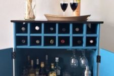 05 a bar cabinet in blue from a 3-drawer Tarva chest from IKEA using scraps of plywood and wood
