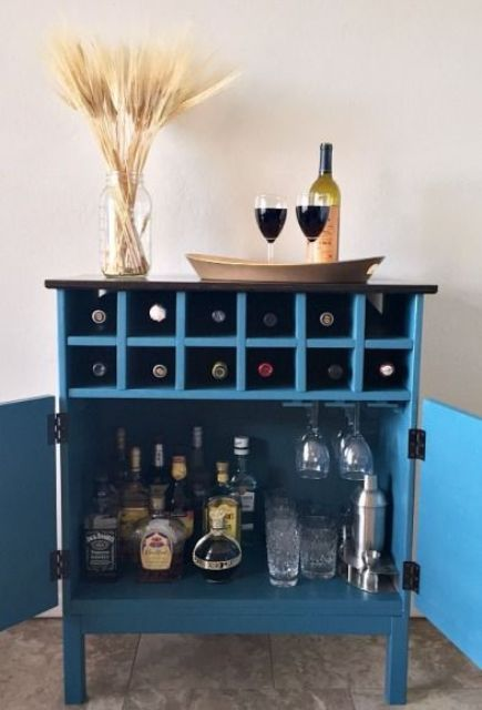 a bar cabinet in blue from a 3 drawer Tarva chest from IKEA using scraps of plywood and wood