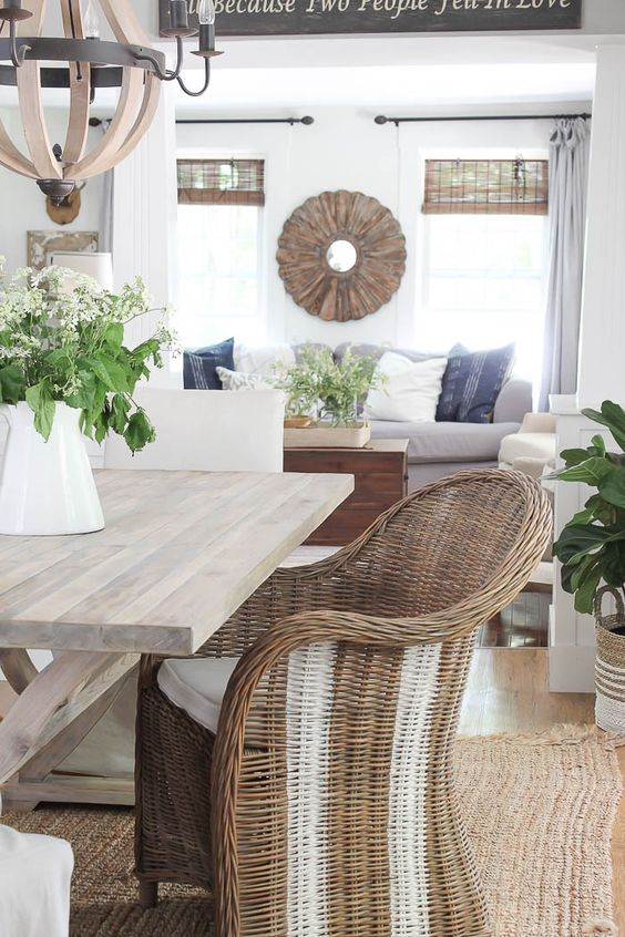 a comfortable wicker chair with white stripes will spruce up a rustic or farmhouse space making it feel summery