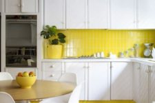 05 a lemon yellow accented kitchen with white cabinets and a yellow skinny tile backsplash that echoes bright accents and touches