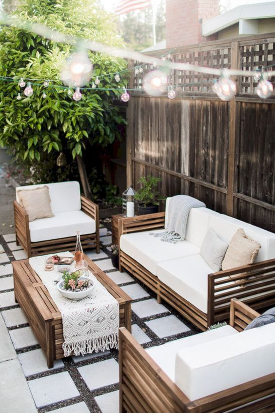 a welcoming patio with a seating group done around a single coffee table in the center