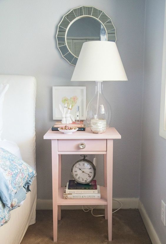 an IKEA Hemnes bedside table hacked in pink and with a metallic knob will add a girlish feel to the space