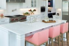 05 pink stools to refresh the monochromatic kitchen and add a fun modern touch to the vintage-inspired space