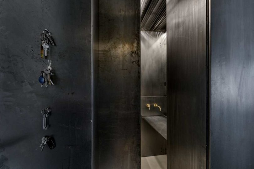 Most of the apartment is clad with aged metal to give it an industrial feel