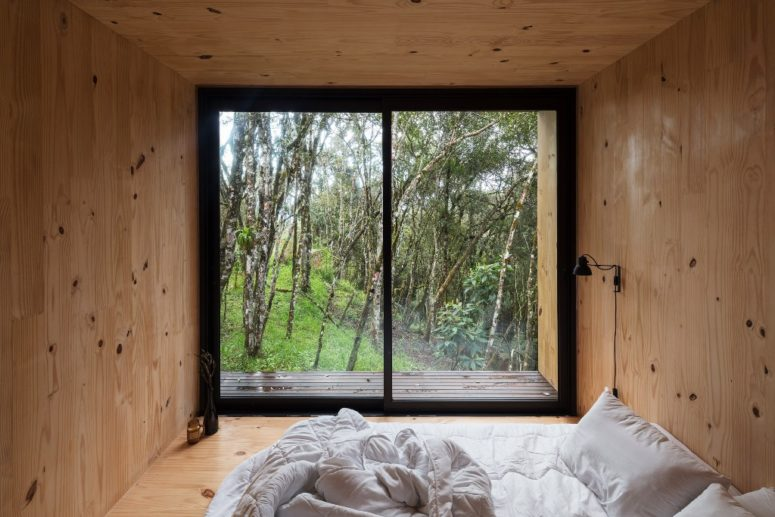 The bedroom features nothing but a comfy bed and a view - you won't need more to unite with nature