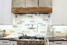 06 a modern farmhouse kitchen with white cabinets and a three tone skinny tile backsplash to add a touch of muted color