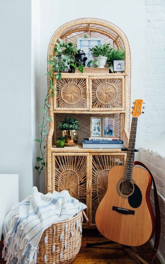 a rattan storage unit with potted greenery and other stuff is a great piece with a 70s feel