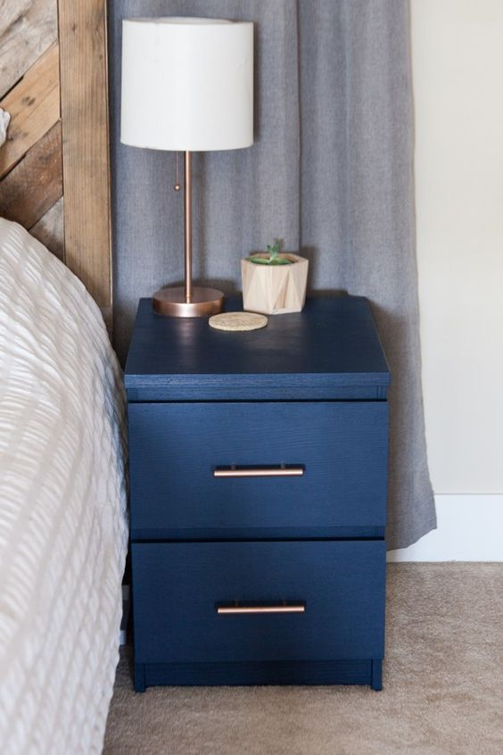 an old IKEA Malm nightstand hacked with navy paint and with metallic handles added for a chic new look