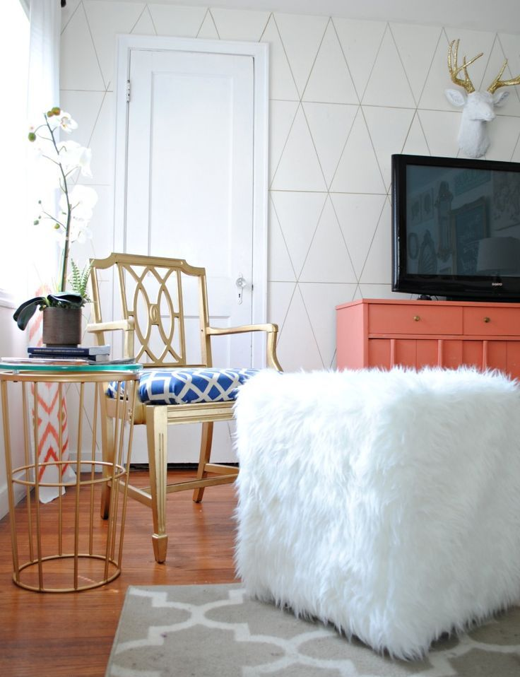 a glam ottoman made of a plywood cube and covered with an IKEA Tejn faux fur skin for a furry touch