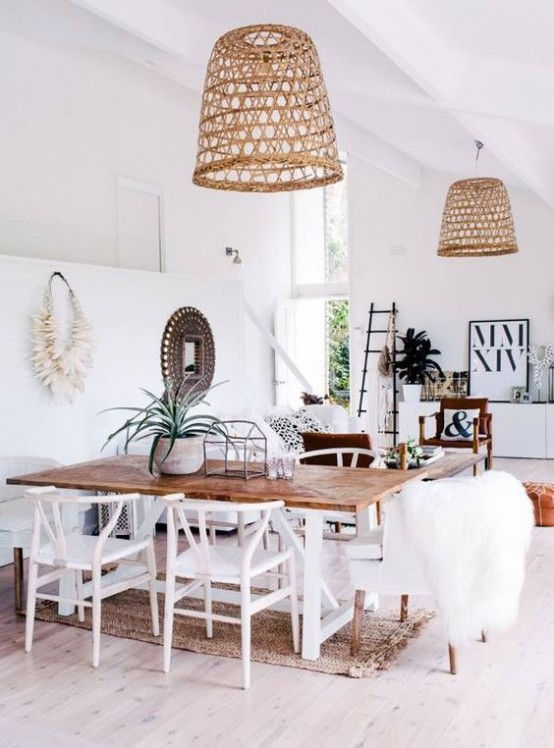 a modern tropical space spruced up with two matching wicker lampshades over the space for a strong beach feel