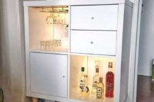 07 a small home bar with open and closed storage compartments with inner lights from an IKEA Kallax shelving unit