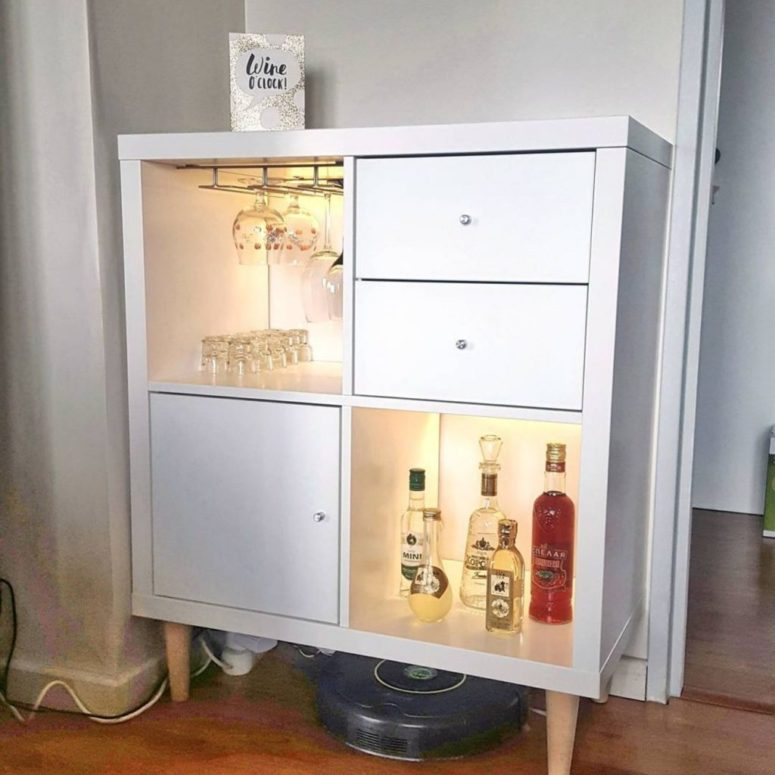 a small home bar with open and closed storage compartments with inner lights from an IKEA Kallax shelving unit