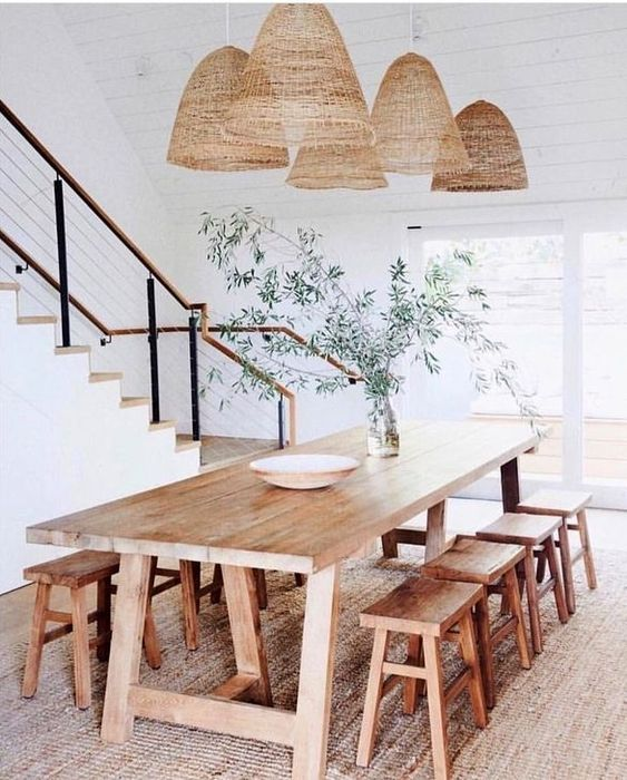 a whole arrangement of wicker lampshades of a large scale are very outdoorsy and summer like