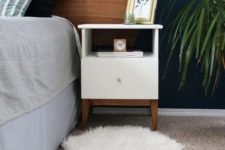 07 an IKEA Tarva nightstand spruced up with white paint, stained legs and a knob is a very cool idea