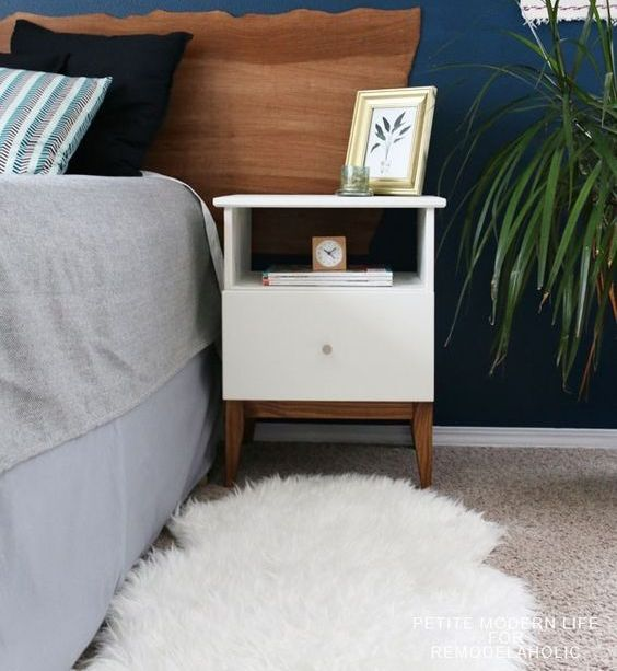 an IKEA Tarva nightstand spruced up with white paint, stained legs and a knob is a very cool idea