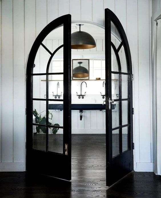 highlight the bathroom with black French arched doors liek these ones, and it will get a super chic look