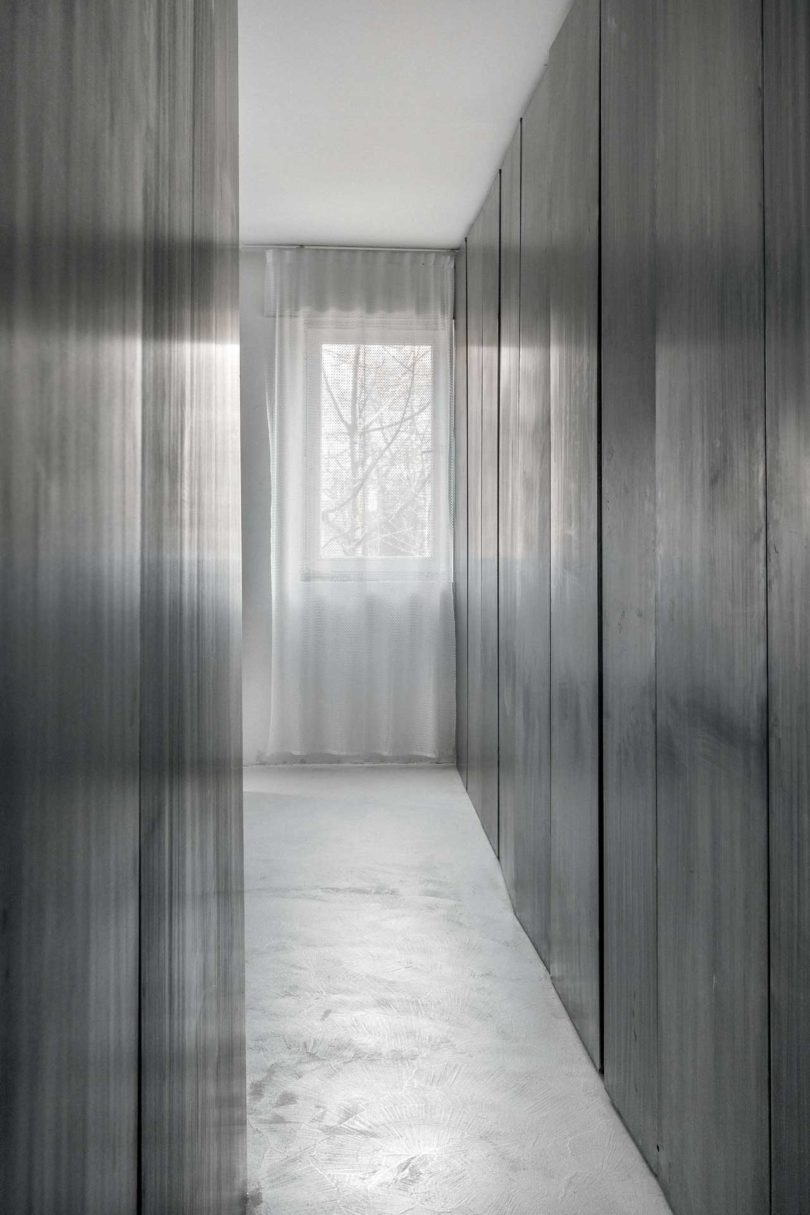 The apartment is filled with light and air thanks to light sheer curtains