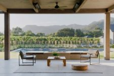 08 There's a swimming pool, a fireplace, some comfy furniture on the terrace and some loungers to enjoy sunshine