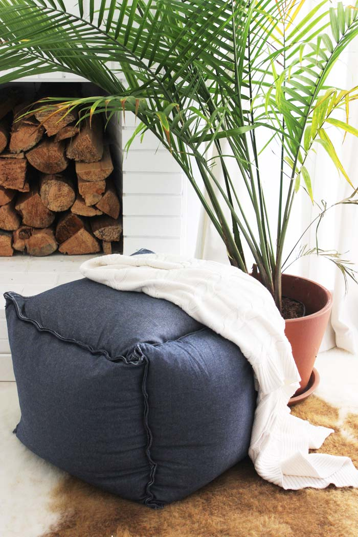 a gorgeous navy modern ottoman made of IKEA Fjadrar cushion inserts and Ormkaktus fabric