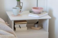 08 an IKEA Tarva nightstand painted white and grey, with a leather pull on the drawer for a mid-century modenr bedroom