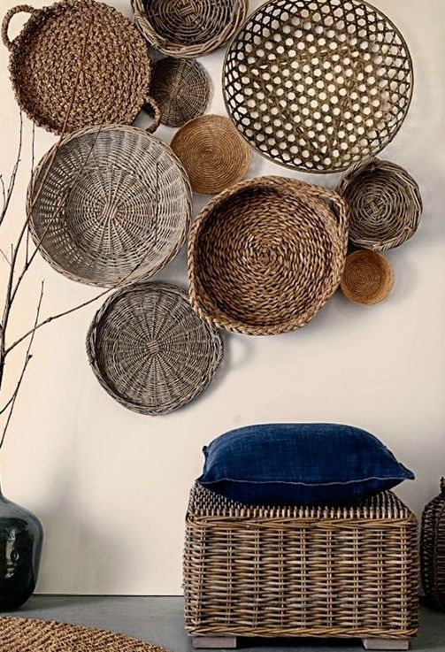 decorative wicker baskets and a wicker pouf that matches make the space more boho and outdoor like