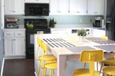 08 industrial and vintage bright yellow stools spruce up the neutral and blue kitchen and stand out a lot