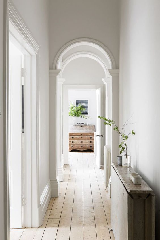 turn your simple corridor into a chic space with arched doorways and vintage touches