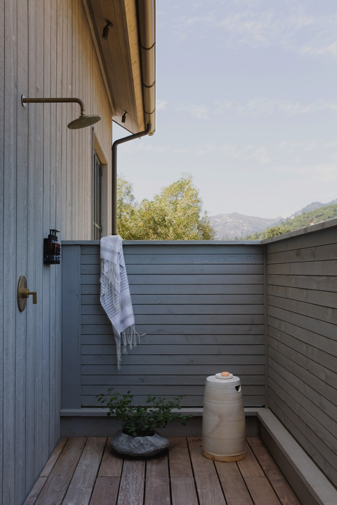 An outdoor shower is fully hidden for more privacy yet allows enjoying fresh air and showering outside