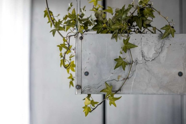 Much greenery was integrated into apartment decor to refresh the metal