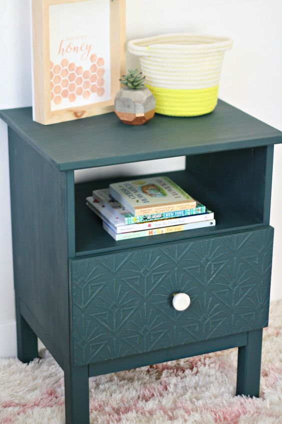an IKEA Tarva nightstand is hacked with faux inlays, a white knob and in forest green color