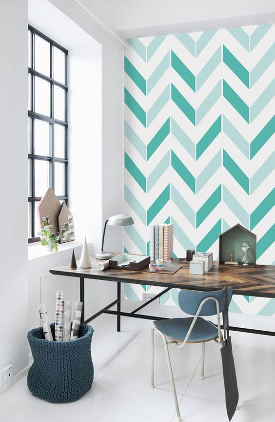 bold mint and green chevron patterns on this statement eall refresh the home office and match the desk