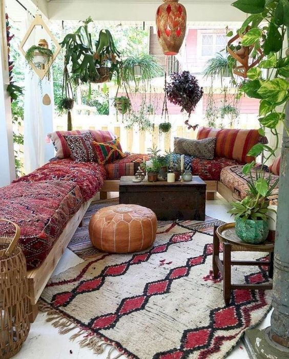 a colorful boho patio with a chest coffee table and all the seating furniture facing it to compose a group