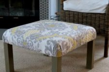 10 a living room ottoman made of an IKEA Lack table with printed grey and yellow fabric on top plus brown legs
