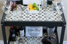 10 a stylish monochromatic bar made of an IKEA Sniglar changing table spruced up with mosaic tiles
