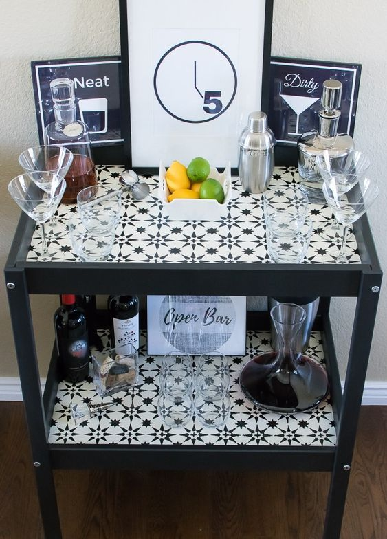 a stylish monochromatic bar made of an IKEA Sniglar changing table spruced up with mosaic tiles